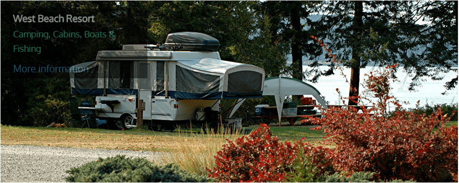 Unpacked RV camp site by the water.